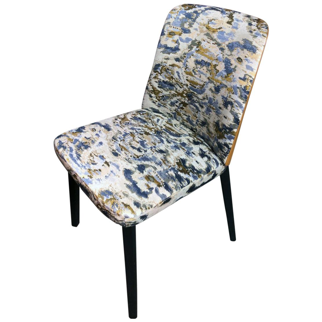 Set of Four Montis Back Me Up Chairs