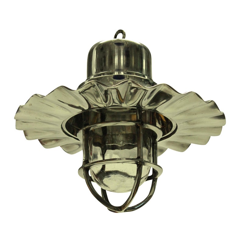 A set of four ship's hanging lights in nickel plate. With an interior glass case housing the light bulb.