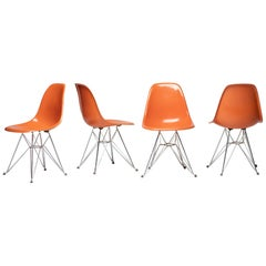 Set of Four Orange Eames DSR Chairs