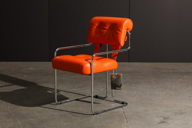 Currently, the most coveted dining chairs by interior designers are 'Tucroma' chairs by Guido Faleschini for i4 Mariani, and we have this incredible set of four (4) Tucroma armchairs in beautiful hot orange leather with polished chrome frames. The