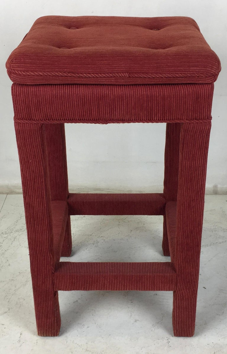 Four handsome classic Parsons style barstools in deep red ribbed cotton upholstery. The set have been reupholstered and can be used as-is if desired. The stretchers double as foot rests allowing the user to revolve to any side or corner. The seats