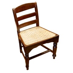 Set of Four Portuguese Rosewood Chairs with Woven Rattan Cane Seats