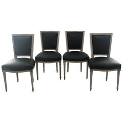 Set of Four Pretty Carved and Painted Louis XVI Chairs with Black Leather Seats