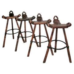 Set of Four Primitive Tripod Bar Stools