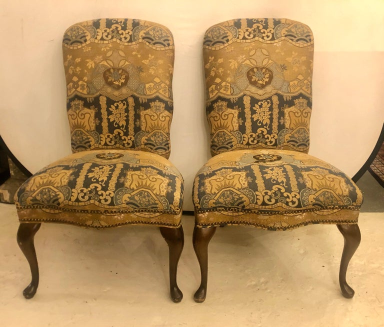 Set of four upholstered high back dining chairs. These strong and sturdy Queen Anne dining chairs are priced to sell immediately. Nicks and some scratches to the legs.