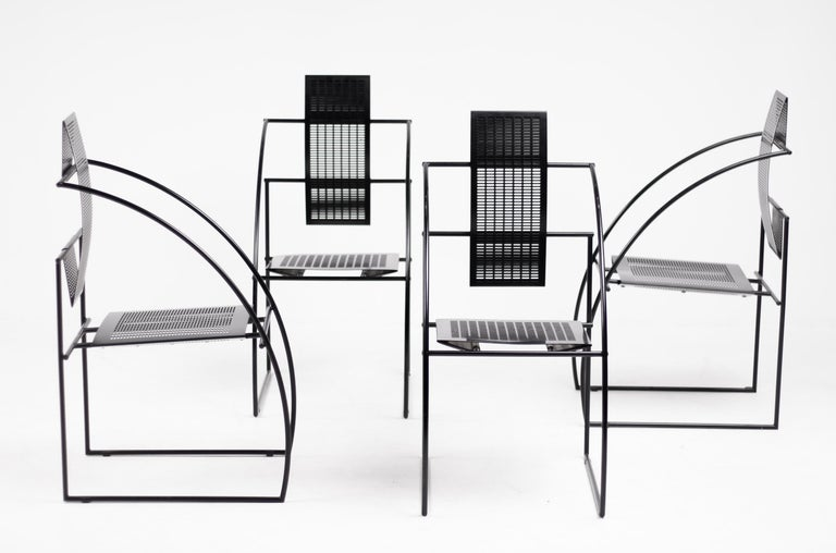 Set of four Quinta chairs by the Italian architect Mario Botta for Alias. The Quinta chair is constructed with steel rod frame and folded perforated sheet metal seat and back. Designed in 1985, marked with label.