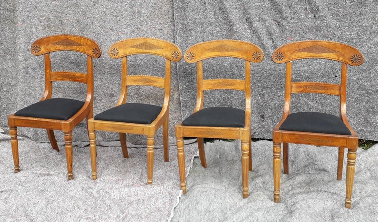 An outstanding set of four Regency chairs rarely made in Ash timber, the top rail flame or crotch veneers are beautifully cut, they are probably London made and amongst the best we've seen.