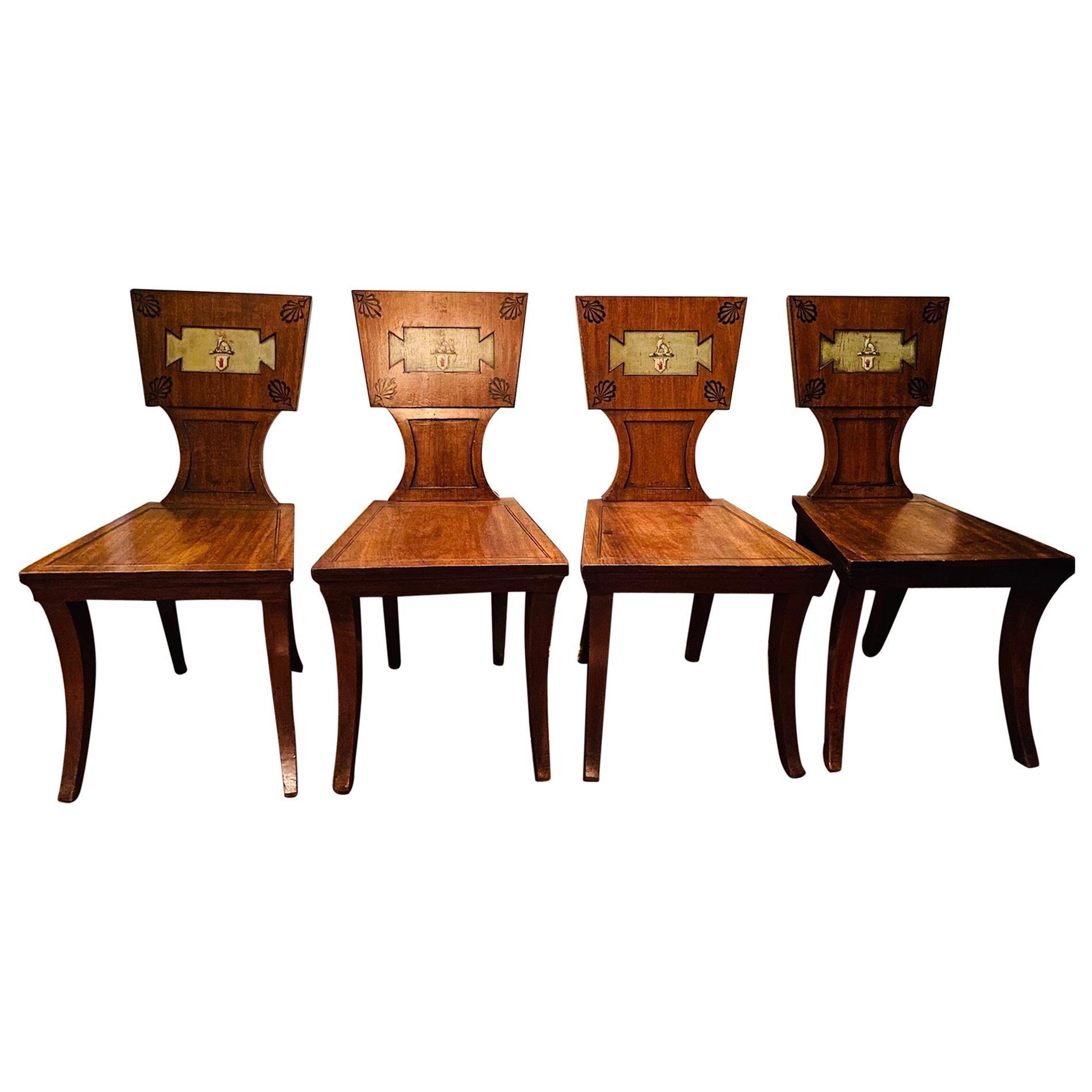 Set of Four Regency Mahogany and Ebony Armorial Hall Chairs