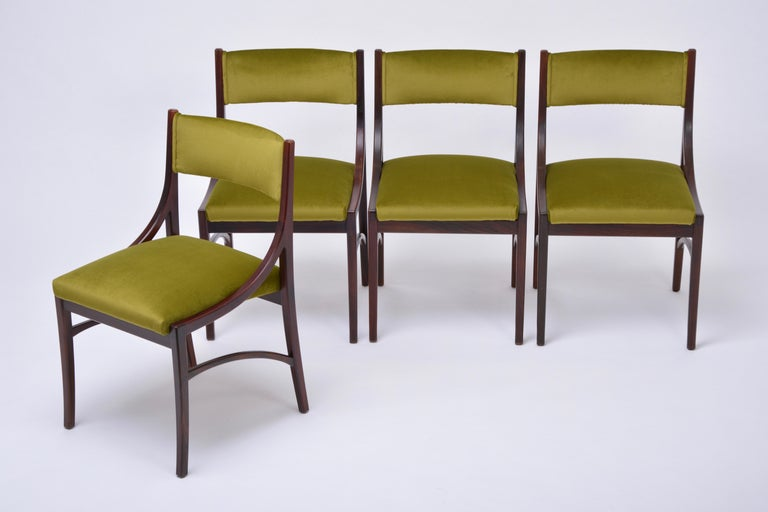 Set of four Mid-Century Modern Green reupholstered Dining Chairs by Ico Parisi Ico Parisi designed the model 110 chair in 1960 for Cassina. The chairs offered here are a version with padded backrest of this model. The frames are made of