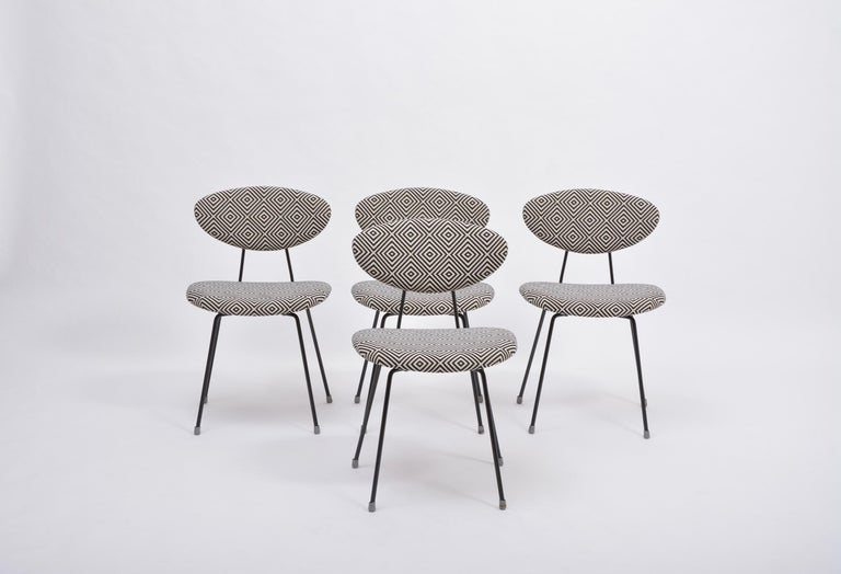 Set of four reupholstered Mid-Century Modern dining chairs by Rudolf Wolf   Set of four dining chairs model 5502 designed by Rudolf Wolf and produced by Dutch company Elsrijk in the 1950s. The chair's frames are made of lackered steel. The chairs