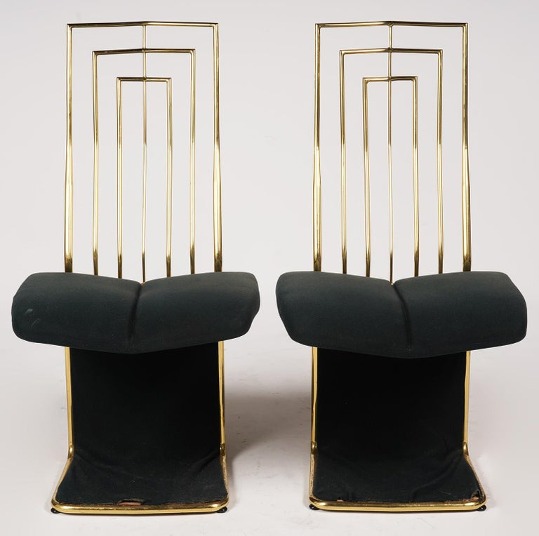 Four late 20th century Hollywood Regency Saporiti style dining chairs featuring an elegant brass framework including grid style backrests with padded velvet seats and velvet covered under-seat panels.