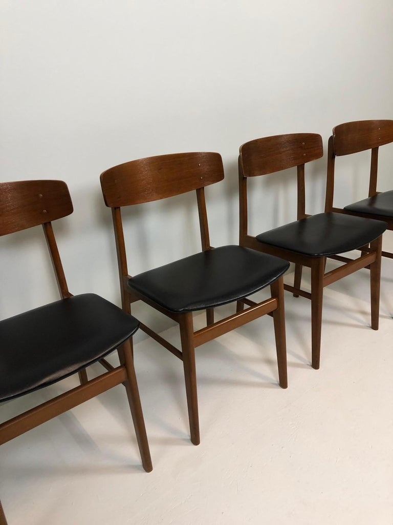 Set of four Sax chairs, made in Denmark, 1960, teakwood base, seat in black imitation leather.