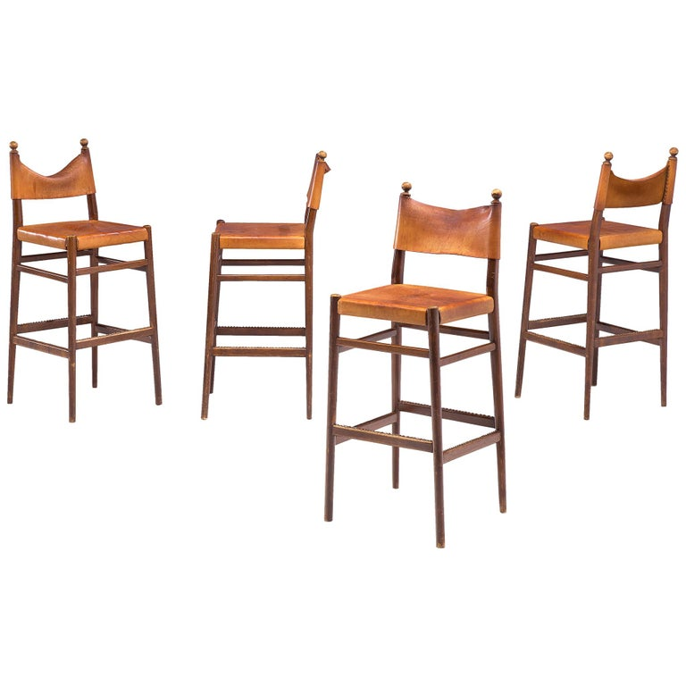 Set of Four Scandinavian Barstools in Patinated Cognac Leather For Sale