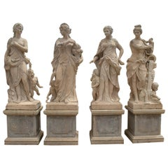 Set of Four Seasons Hand Carved Travertine Marble Sculptures with Bases