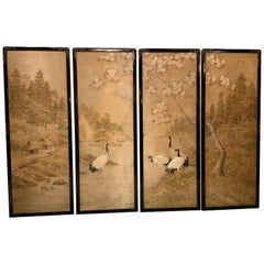 Set of Four Silk Embroidered Asian Panels in Ebonized Black Lacquered Frames