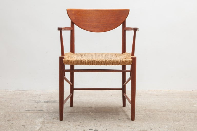 Mid-Century Modern teak dining, side set of four arms chairs in solid teak with sleek spindle legs and woven seats designed in the early 1950s by Peter Hvidt and Orla Mølgaard-Nielsen for the manufacture Soborg Mobler in 1956. Dimensions: Chairs 60