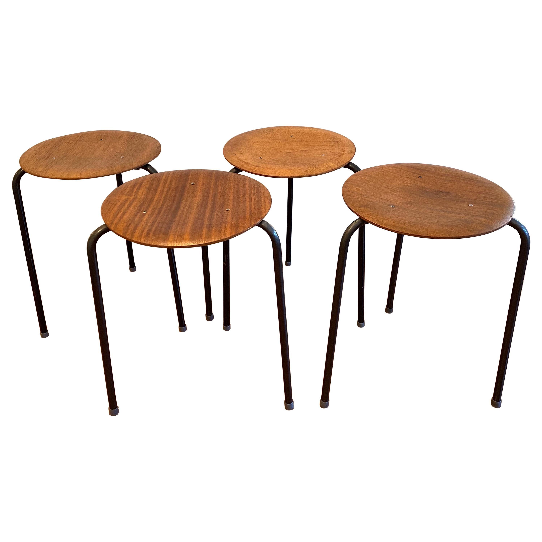 Set of Four Stacking Teak Stools by Arne Jacobsen