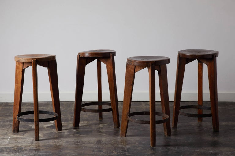 Set of four teak and steel stools by Pierre Jeanneret for Punjab University in Chandigarh. Made in France/India, circa 1965.