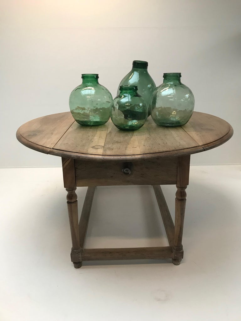 Nice set of 4 storage Jars in glass, nice green, transparent color Some of them marked VIRESE BARCELONA Can be used in the kitchen or as a vase Different sizes High 30, diameter 25 High 35, diameter 31 High 36, diameter 30 High 43, diameter