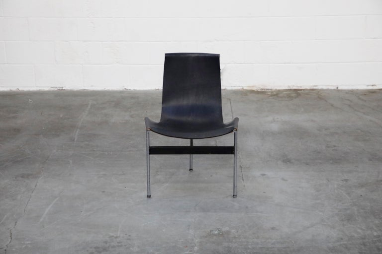 These iconic three legged steel and leather sling 'T-Chairs' by William Katavolos, Douglas Kelley & Ross Littell for Laverne International were designed in 1952. This set of four are collectible early production examples with original leather and