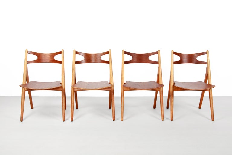 Very nice dining room chairs, designed by Hans Wegner and produced by Carl Hansen and Son in Odense, Denmark. It is a very old set in good condition. The frame of the chairs consists of solid beech wood and the seat and backrest of veneered teak.