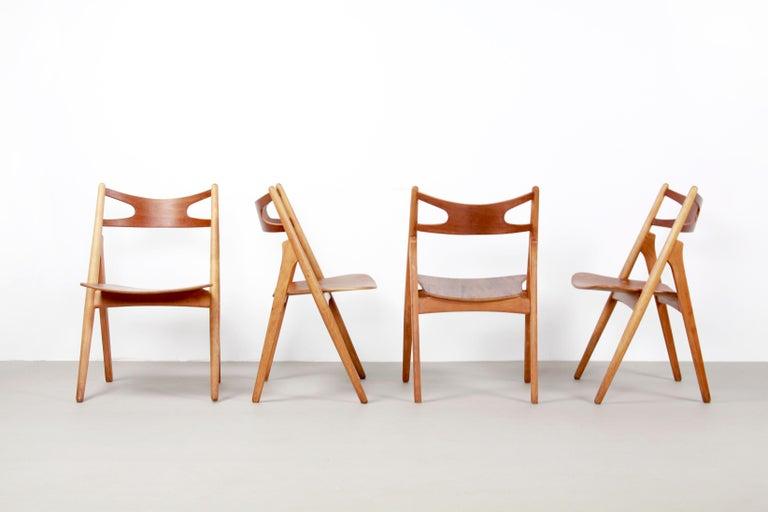 Scandinavian Modern Set of Four Teak Hans J Wegner Sawbuck Model CH29 Chairs by Carl Hansen For Sale