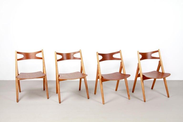 Danish Set of Four Teak Hans J Wegner Sawbuck Model CH29 Chairs by Carl Hansen For Sale