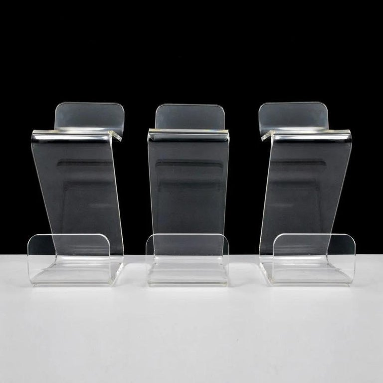 Set of four bar stools in thick Lucite by Gary Gutterman, circa 1970.