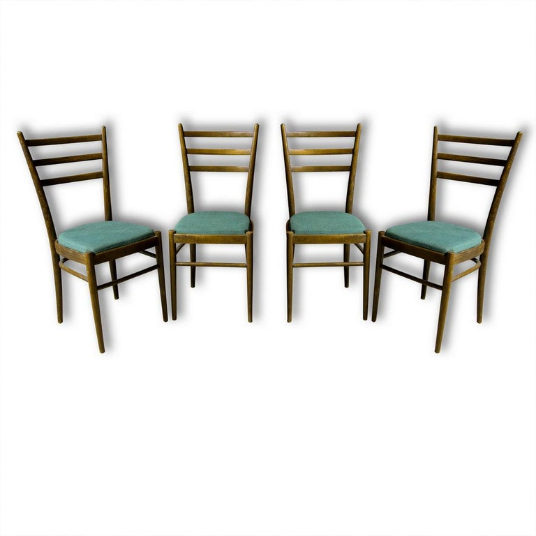 Lovely dining chairs Ton, made in Czechoslovakia, 1960s. Beechwood, green fabric. In very good Vintage condition, without any damage. Price is for the set of four.