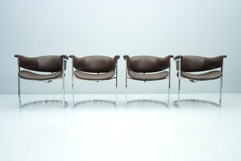 Set of four Vittorio Introini chairs in chrome and brown leather, Italy 1970s. Very good condition.