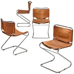 Set of Four Tubular Dining Chairs with Patinated Cognac Leather Upholstery