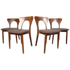 Set of Four Unusual Midcentury Walnut Dining Chairs