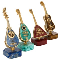 Set of Four Vermeil and Hardstone Miniature Musical Instruments
