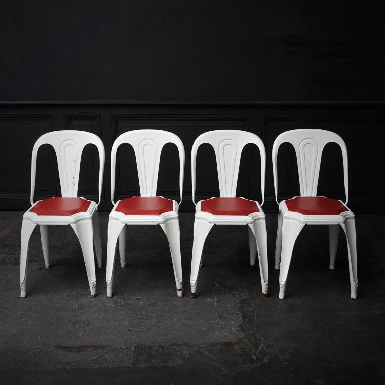 Rare 1950s Fibrocit Industrial steel structure chairs. One of the first stackable and stainless terrace chairs, also known as the Belgian Tolix.