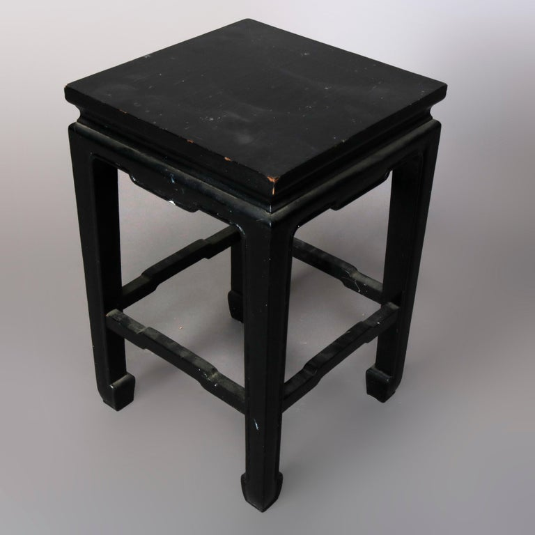 A vintage set of four matching Chinese side stands offer black lacquered wood construction with square tops surmounting frame with shaped stretchers, 20th century  ***DELIVERY NOTICE – Due to COVID-19 we are employing NO-CONTACT PRACTICES in the