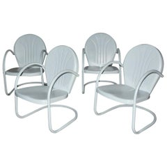 Set of Four Vintage Clam Shell Metal Spring Armchairs