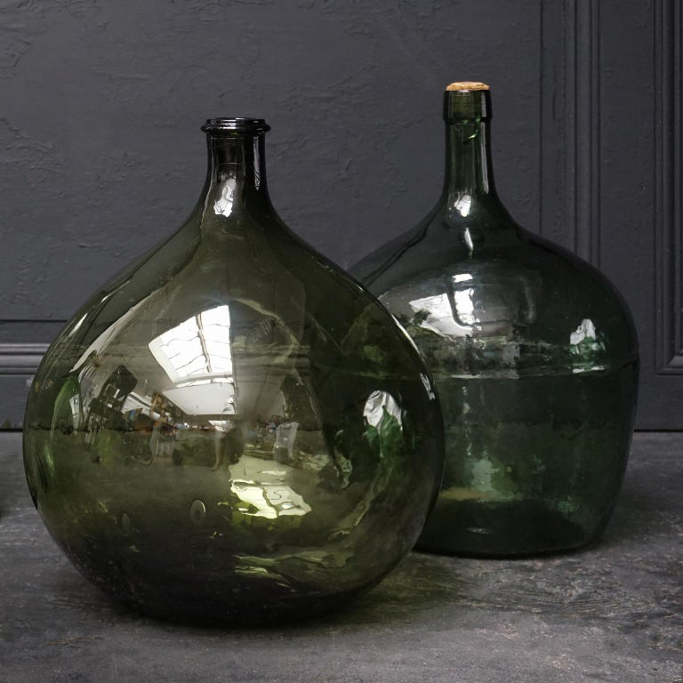 Set of Four Vintage Green Glass Bottles Demijohns, Lady Jeanne or Carboys In Good Condition For Sale In Haarlem, NL