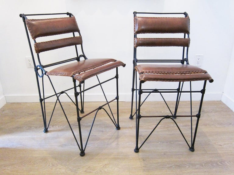 Set of four vintage iron and stitched leather bar stools, 
