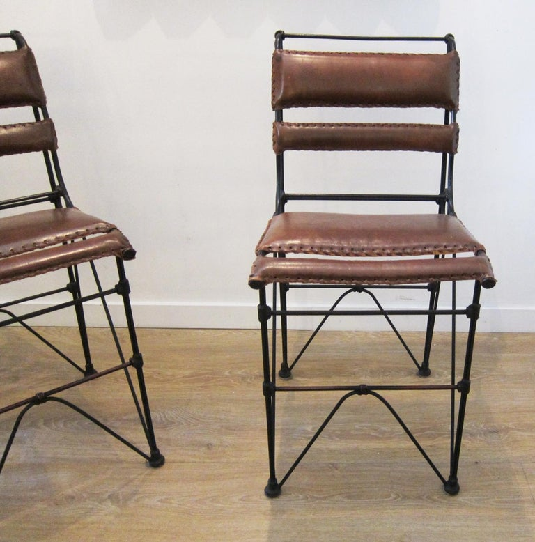 North American Set of Four Vintage Iron and Stitched Leather Bar Stools For Sale