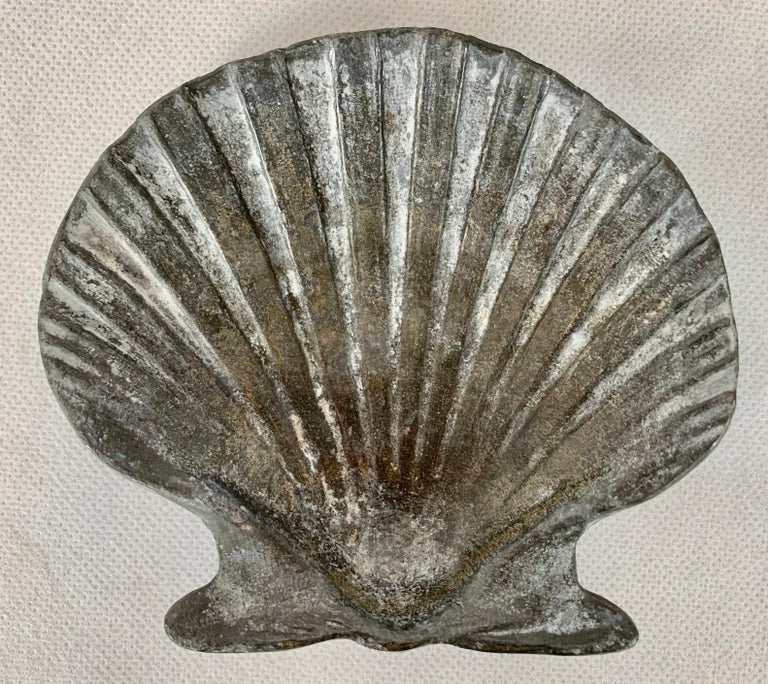 Garden items made from lead were ideal as they do well in most climates and achieve a favorable patina. This set of four are scallop shells and well modeled. I imagine they could be built into a wall, corners of a floor or used strictly for