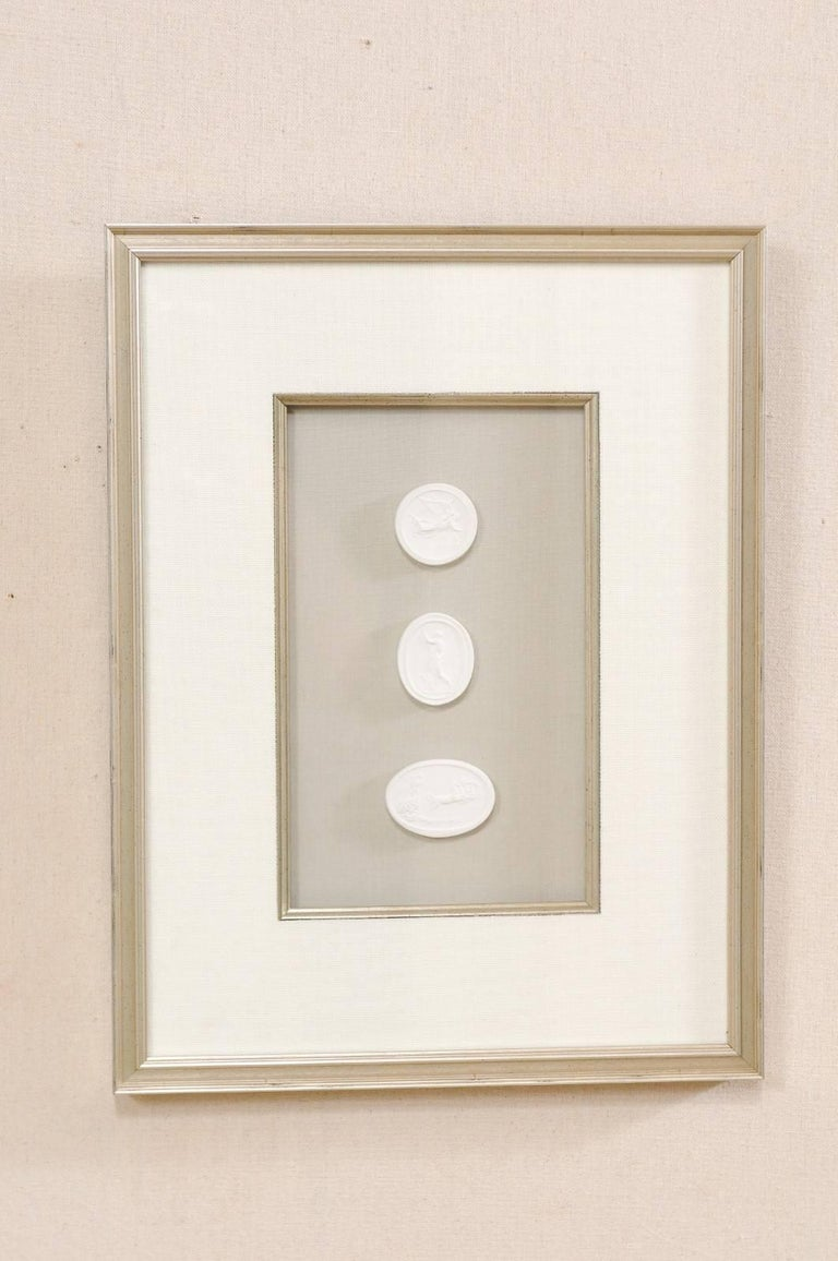 Greco Roman Set of Four Wall Decorations of Hand-Cast White Intaglios in Silver Leaf Frames For Sale