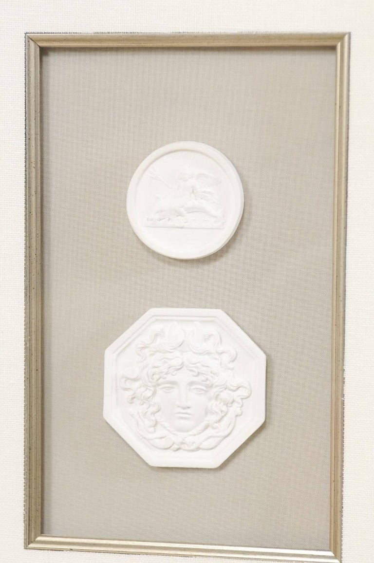 Set of Four Wall Decorations of Hand-Cast White Intaglios in Silver Leaf Frames In Excellent Condition For Sale In Atlanta, GA