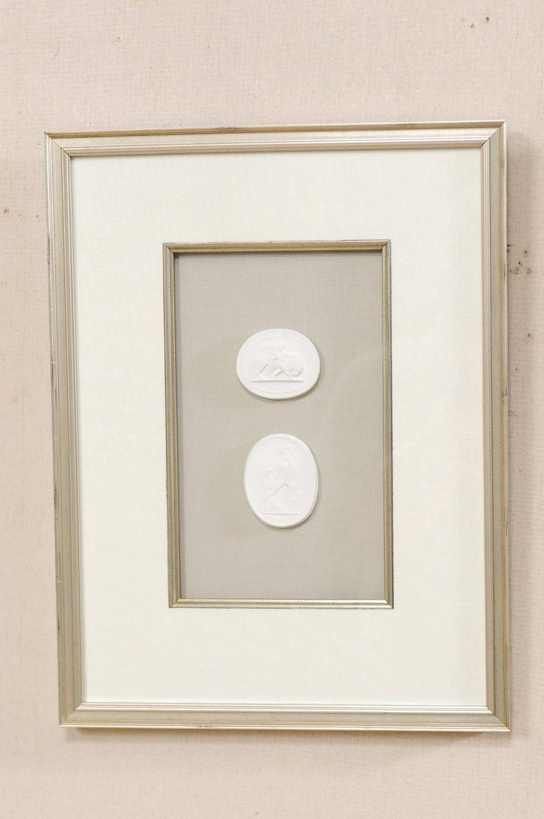 Set of Four Wall Decorations of Hand-Cast White Intaglios in Silver Leaf Frames For Sale 1