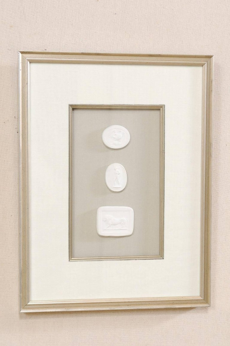 Set of Four Wall Decorations of Hand-Cast White Intaglios in Silver Leaf Frames For Sale 2