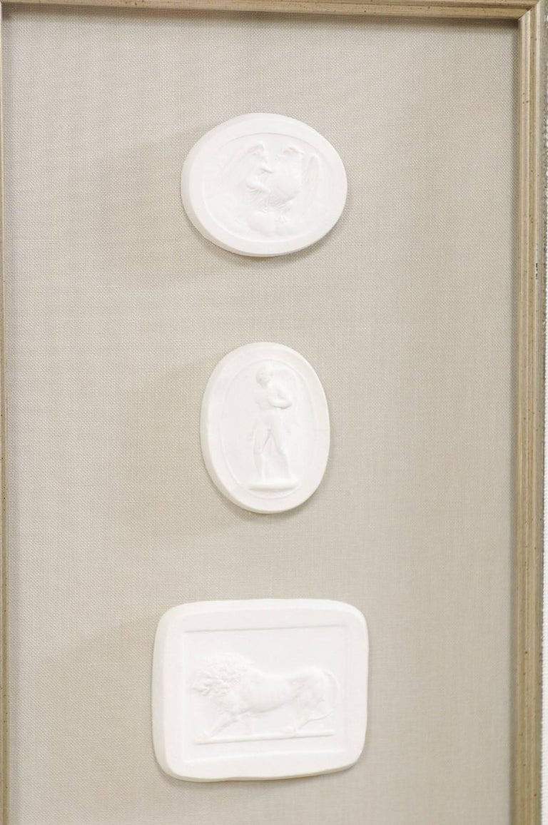 Set of Four Wall Decorations of Hand-Cast White Intaglios in Silver Leaf Frames For Sale 3