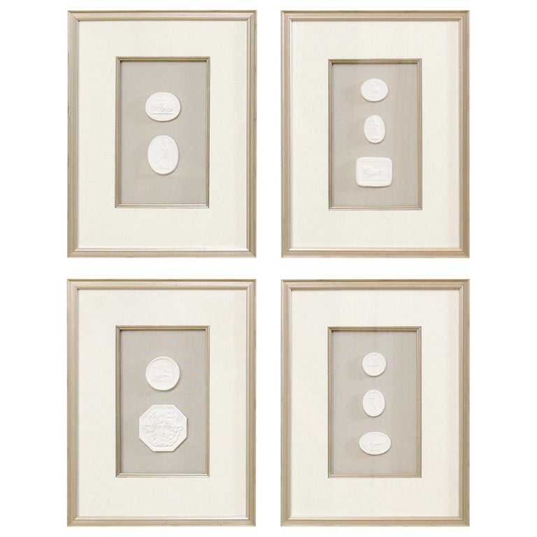 Set of Four Wall Decorations of Hand-Cast White Intaglios in Silver Leaf Frames For Sale