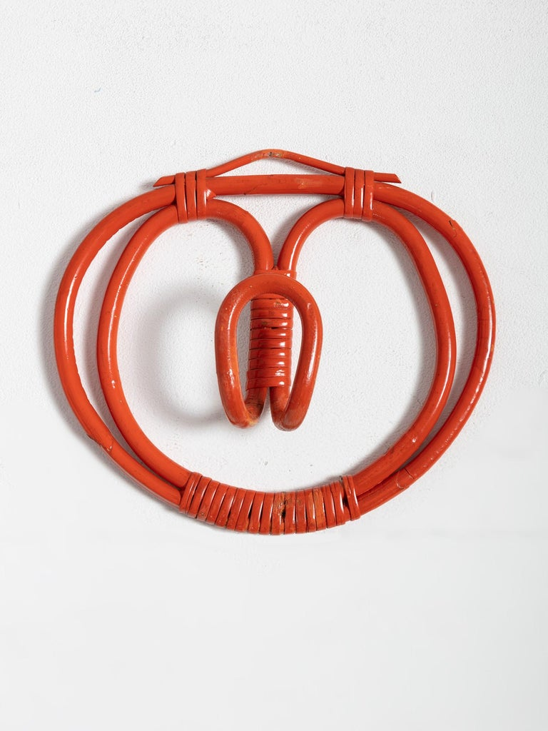 Four wall hooks by Franco Albini and Franca Helg for Bonacina. Abstract wicker sculptures in rare red version.