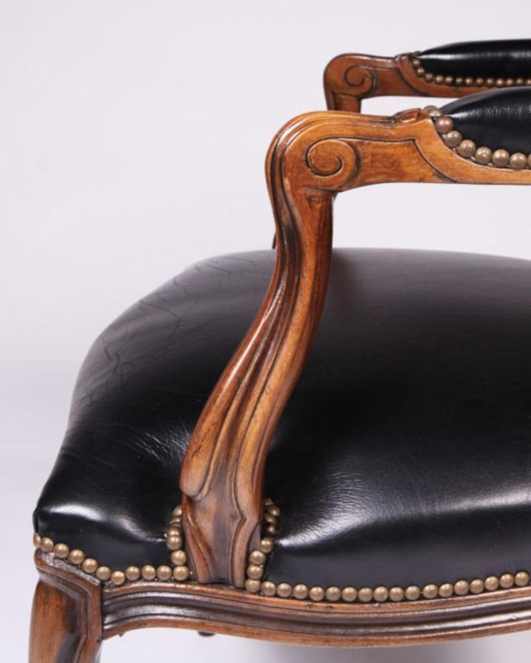 Louis XV Set of Four Walnut and Leather Fauteuil For Sale