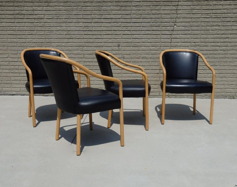 Set of four ash frame chairs upholstered in black leather. Designed by Ward Bennet for Brickel Associates. Condition is superb.