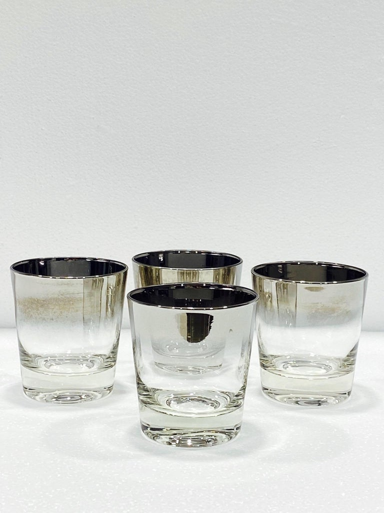 Iconic Mid-Century Modern barware glasses with silver fade overlay design. Great looking rock glasses with tapered forms and gradient rims with in ombre gunmetal. Makes a smart and handsome addition to any barware collection.